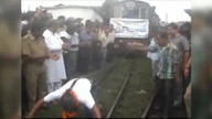 Indian man uses ponytail to pull train