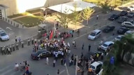 Beijing protesters surround US Ambassador's car