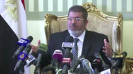 Egypt's Morsi greets freed security personnel
